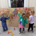 kids painting on a board