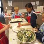 kids making spinach and cheese triangles