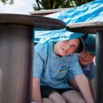 moonah-primary-kids-playing-under-tarp-smiling-2